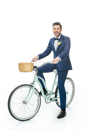 cheerful groom riding retro bicycle Stock Photo