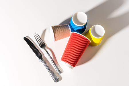 colorful paper cups and cutlery on white Stock fotó
