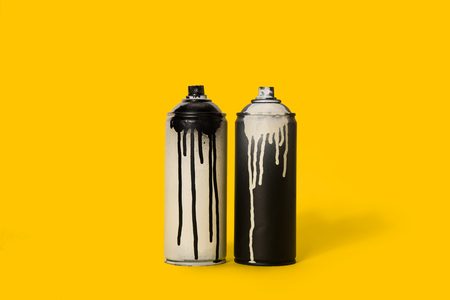 close up view of black and white aerosol paint in cans Stock Photo - 93683582