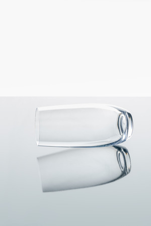 glass on white reflecting surface