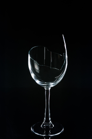 wineglass on black reflecting table