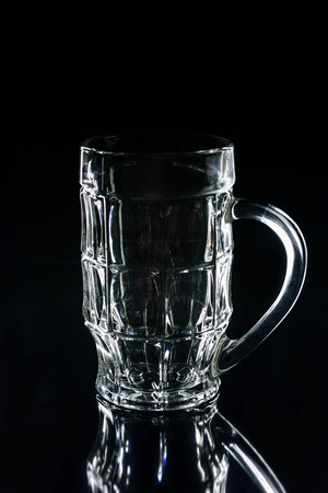 beer glass on black reflecting surface
