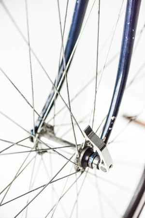 close up of bicycle wheel with spokes and fork