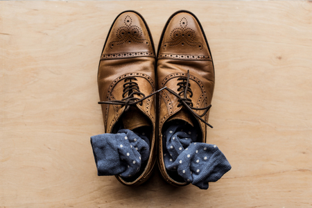 brown male shoes with socks inside