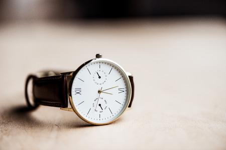 Modern watch on wooden table Foto de archivo