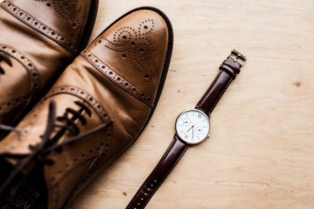 top view of brown shoes and watch