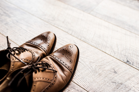 A pair of leather brown shoes