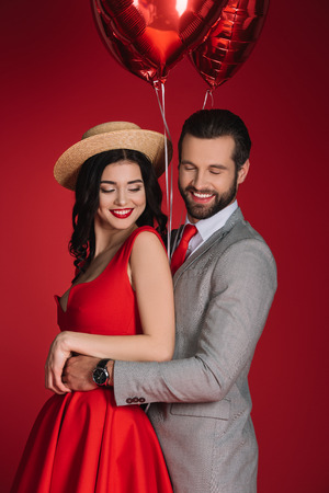 smiling stylish couple with red balloons Stok Fotoğraf