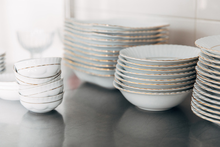 various stacked clean tableware at restaurant