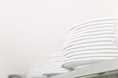 stacks of clean tableware at restaurant on shelf