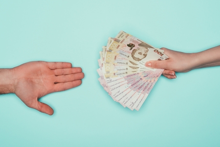 People passing cash isolated on turquoise Stock Photo