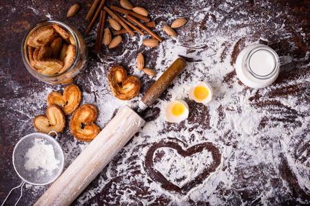 tasty homemade cookies and ingredients on table top Stock Photo
