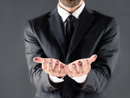 cropped view of businessman with open hands Imagens