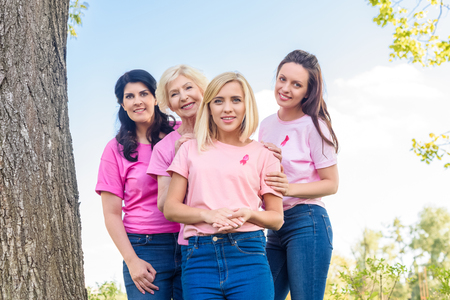 women in pink t-shirts with ribbons Stock Photo