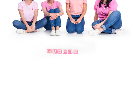women in pink t-shirts with cancer inscription Archivio Fotografico