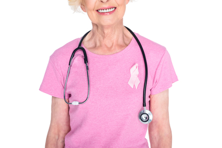 senior woman with pink ribbon and stethoscope