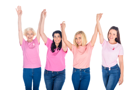 women in pink t-shirts holding hands