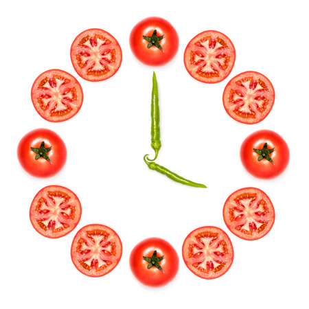 clock made of tomatoes and peppers