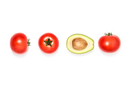 tomatoes and half of avocado Stock Photo
