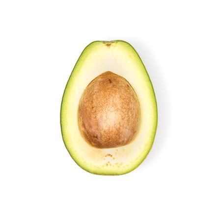 half of fresh avocado with seed Stock Photo