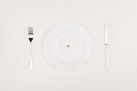 pea on plate, cutlery