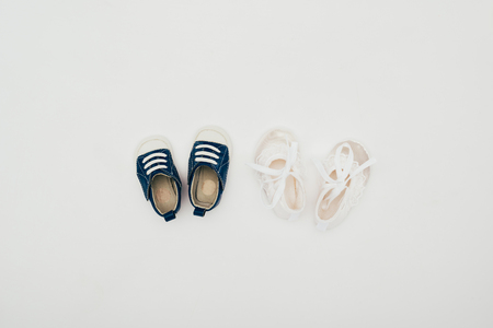 top view of two pairs of baby shoes Stock Photo