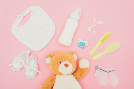 top view of teddy bear and baby equipment