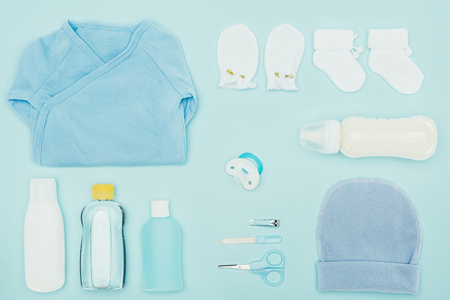 top view of baby clothes and bathroom accessories