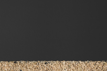 raw rice isolated on black with copy space Stock Photo