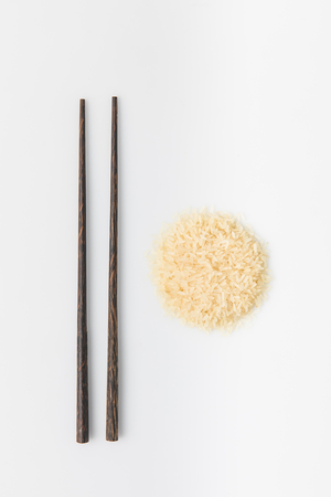 heap of rice with chopsticks isolated on white Reklamní fotografie - 94223081