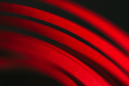 close up view of red quilling striped paper on black Stock Photo - 94392717