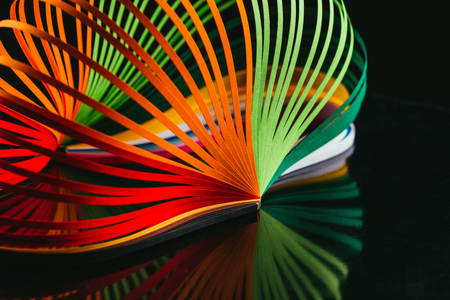 colored quilling paper curves on black Stock Photo