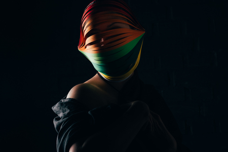 woman with colored quilling paper on head