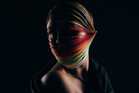 woman with colored quilling paper on head looking away
