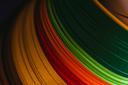 close up of colored bright quilling paper on dark Stock Photo