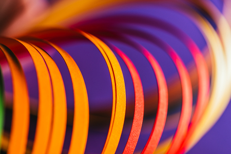 close up of yellow and red quilling paper curves on purple Stock Photo