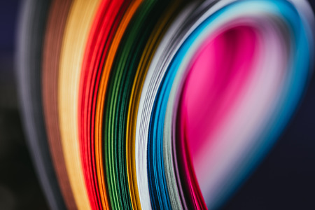colored bright quilling paper curves on black