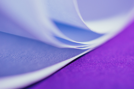 close up view of white paper on purple surface