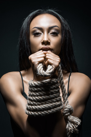 african american woman trapped with rope