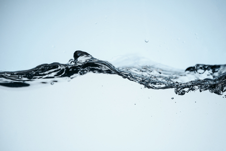 minimalistic background with flowing water, isolated on white Banque d'images