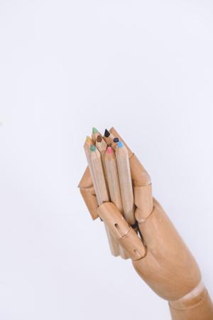 close-up beeld van dummy bedrijf kleurrijke kleurpotloden geïsoleerd op wit Stockfoto