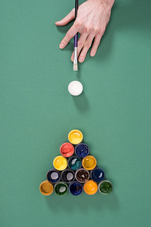 cropped shot of person playing billiard with paints Reklamní fotografie