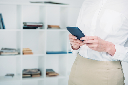 businesswoman messaging with smartphone