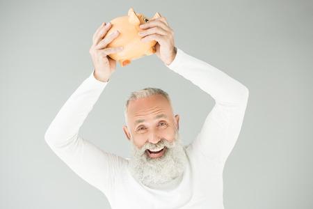 senior man with piggy bank