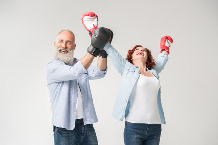 couple triumphing in boxing gloves Stock Photo