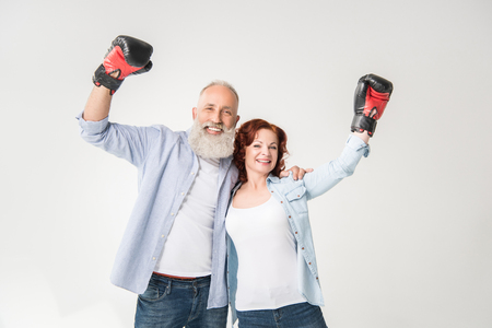 mature couple in boxing gloves Stock Photo