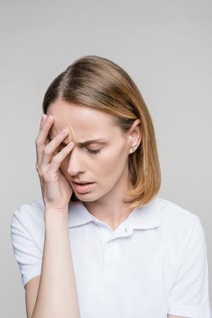 upset woman with headache