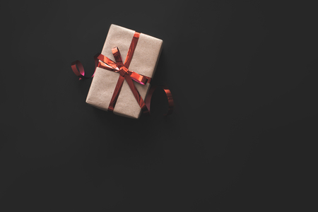 Christmas present with ribbon on black isolated background. Stock Photo