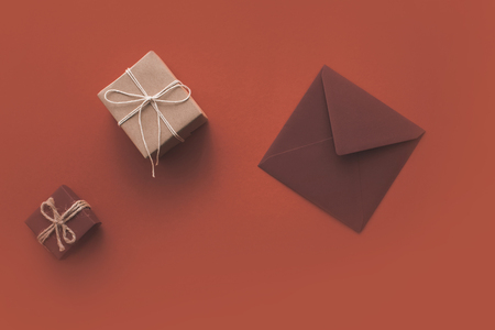 Christmas presents and envelope on red isolated background. Stock Photo
