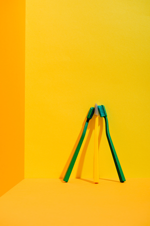 Green and yellow toothbrushes